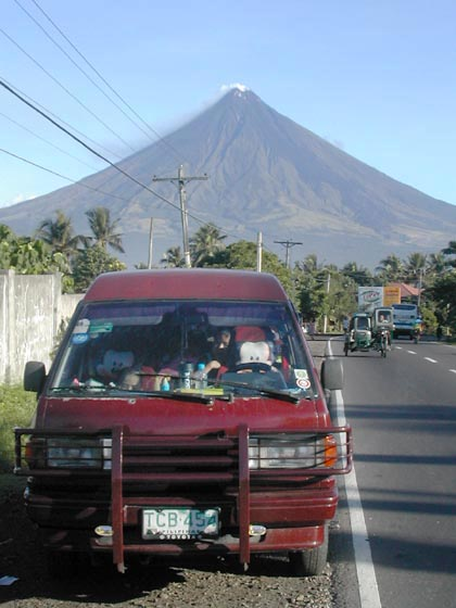 Mayon Volcano seen the side mirror.